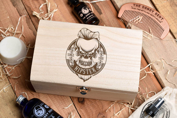 Wooden box on a wooden table top with engraved skull and personalised engraving by Original Monkey Gifts.