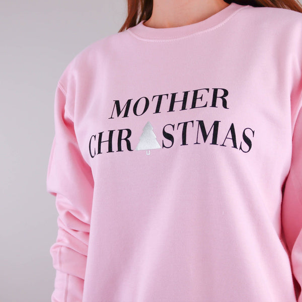 Woman wearing a pink jumper with text reading 'Mother Christmas' by Original Monkey Gifts.