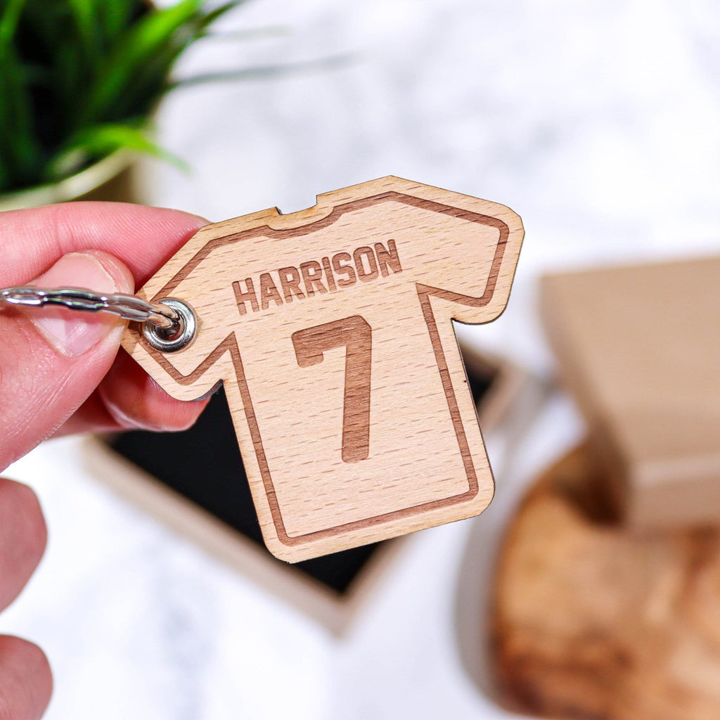 T shirt shaped wooden keyring with personalised name and number by Original Monkey Gifts.