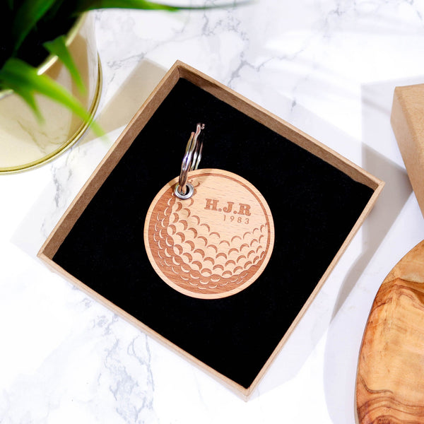 Circular wooden keyring with gold ball design and initials engraved on top by Original Monkey Gifts.
