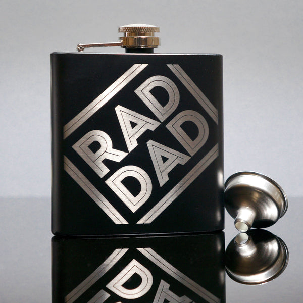 Black hipflask with laser engraved message that reads 'rad dad' by Original Monkey Gifts.