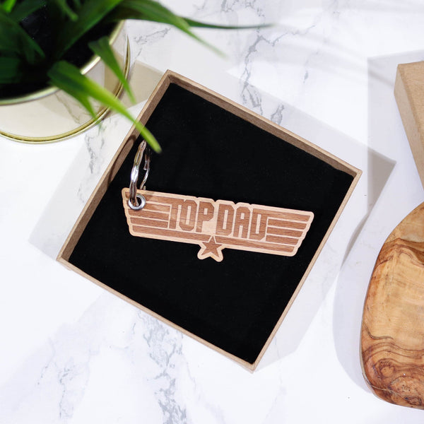 Wooden keyring with engraving that reads 'top dad' in gift box with black insert by Original Monkey Gifts.