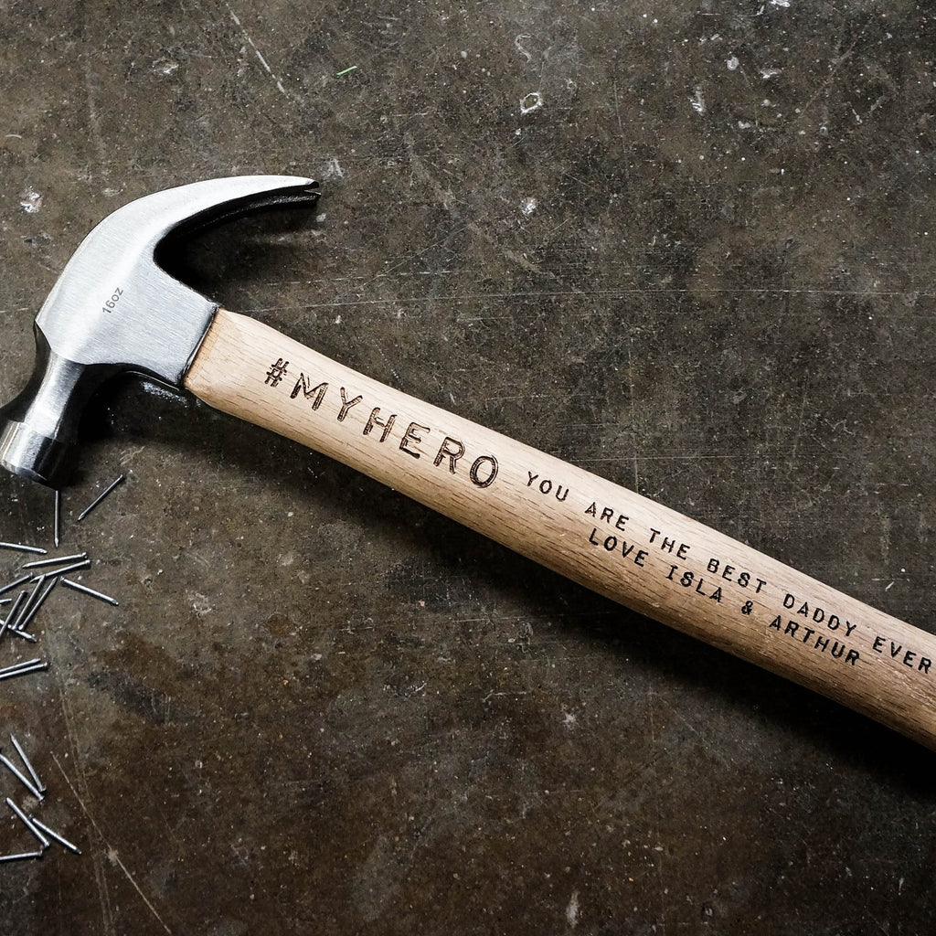 Wooden hammer with personalised engraving that reads 'my hero' by Original Monkey Gifts.