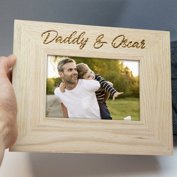 Solid oak frame with personalised engraving that reads 'daddy and oscar' by Original Monkey Gifts.