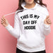 woman wearing white hoodie with This is my Day off Hoodie in black text made by Original Monkey