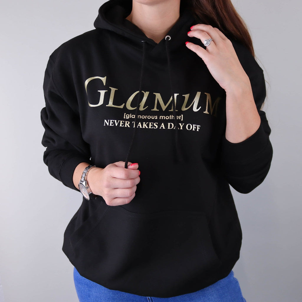 "Woman wearing black Hoodie with gold text which says ""Glamum Never takes a Day off"" by Original Monkey Gifts"