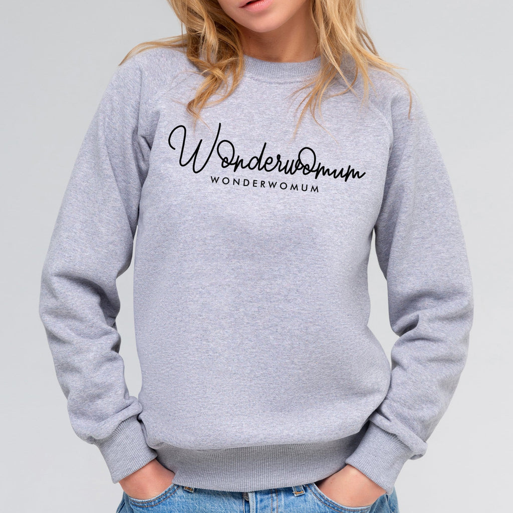 Woman wearing grey raglan sleeved sweater with personalised text reading Wonderwomum in black, paired with blue denim jeans. By Original Monkey Gifts.