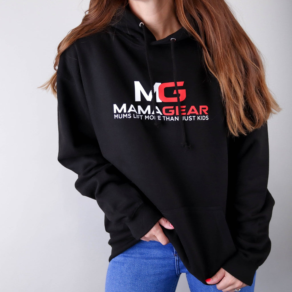 Woman wearing a black hoodie with white and red text reading MamaGear, mum's lift more than just kids, paired with blue jeans. By Original Monkey Gifts