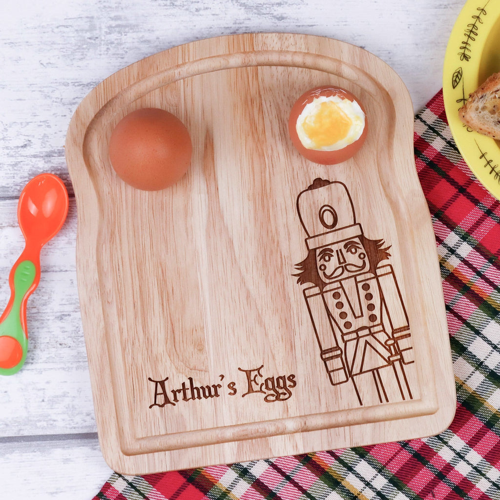 Egg breakfast board with personalised engraving and nutcracker figure by Original Monkey Gifts.