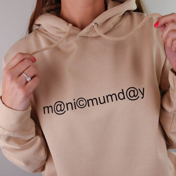A woman wearing a sand coloured hoodie which says manic mumday creating a great gift idea for any mum made by Original Monkey Gifts