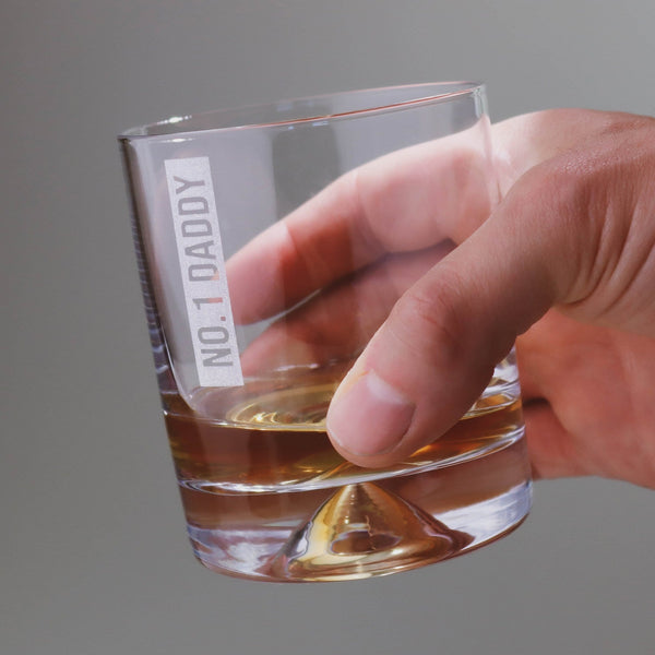 Man's hand holding a tumbler glass with personalised message that reads 'No1 Daddy' by Original Monkey Gifts.