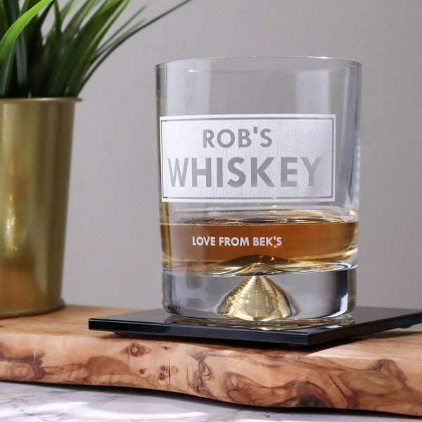 a personalised whiskey tumbler with heavy base and detailing, professionally engraved