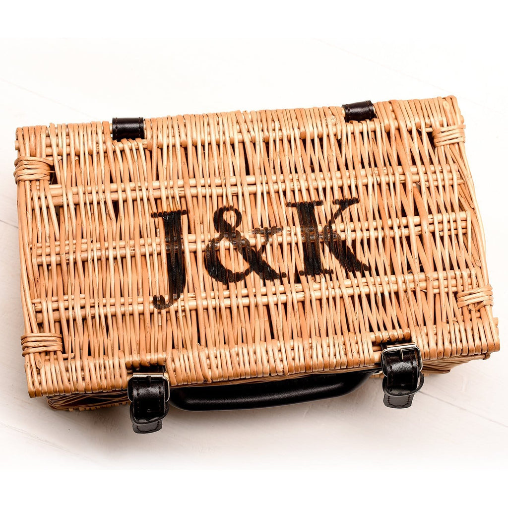 A personalised willow hamper with the initials 'j and k' engraved on top by Original Monkey Gifts.
