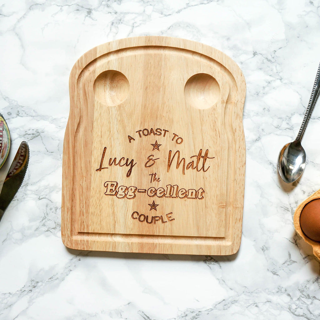 Wooden egg breakfast board with couple personalisation by Original Monkey Gifts.