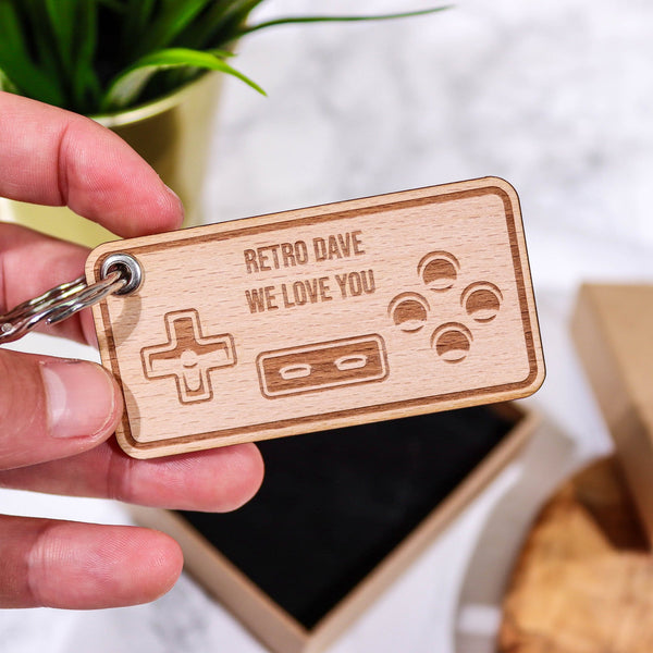 Wooden keyring with a games controller engraved and personalised message by Original Monkey Gifts.