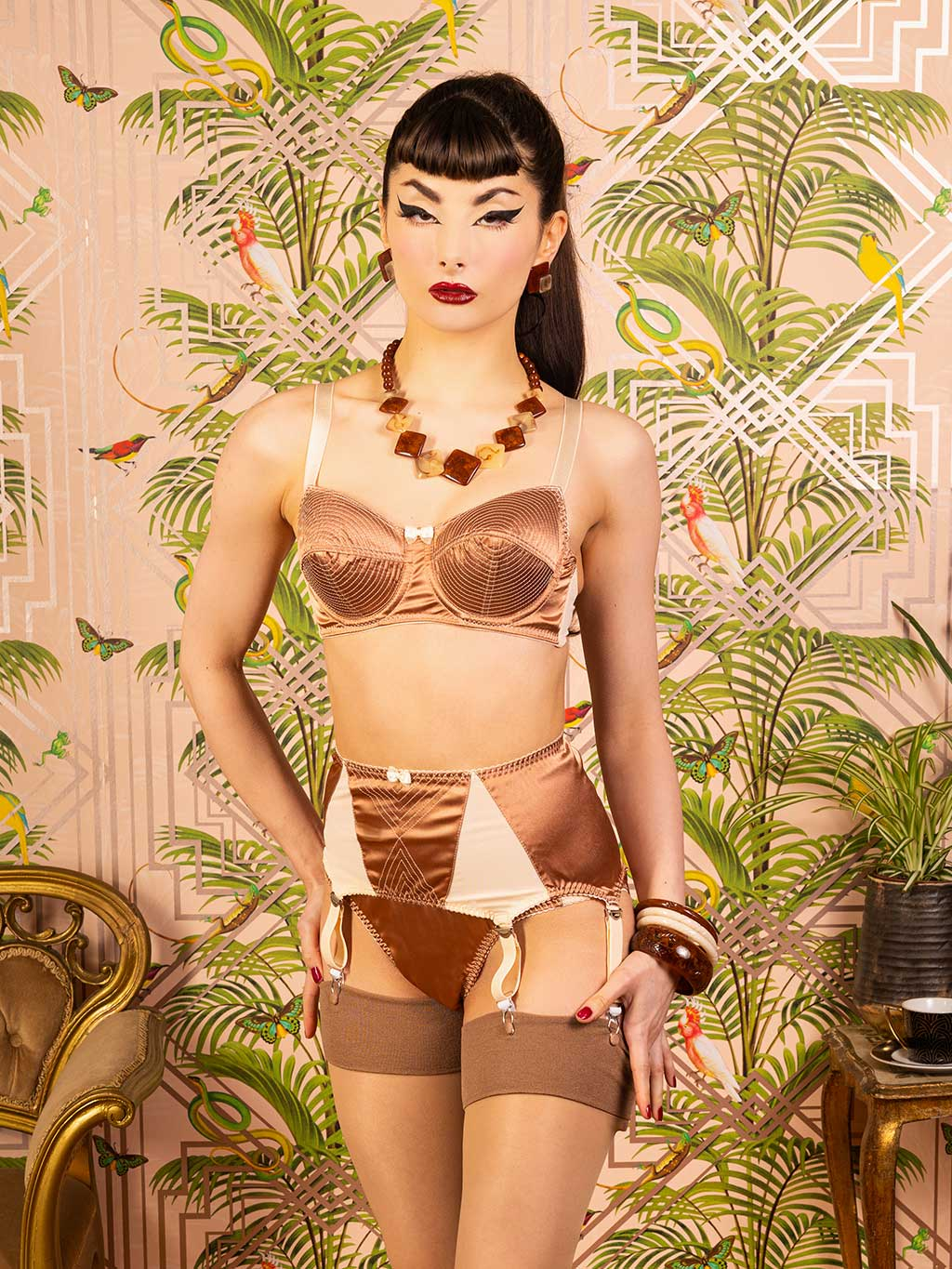 Vintage style six strap suspender belt by What Katie Did.  Made from latte satin and peach power mesh with vintage stitching detail to front
