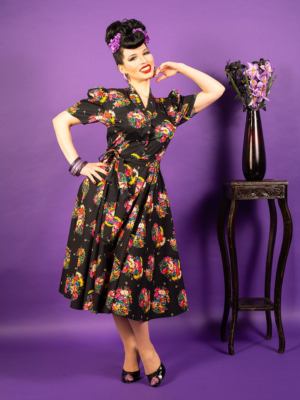 1950s floral dress.  Retro black cotton shirtwaist dress with floral print.  Fitted top with full skirt falling just below the knee.