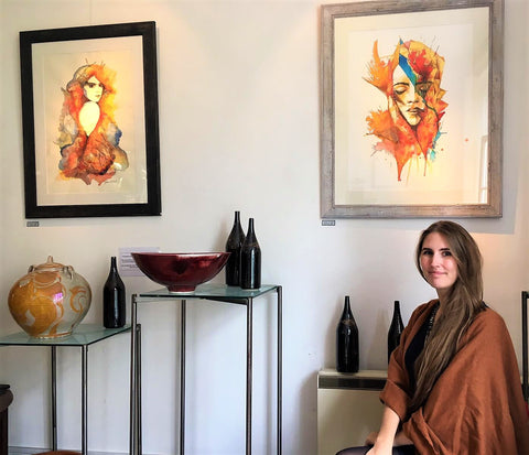 Gemma Corvalan with her two paintings