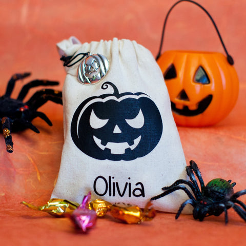 White personalised Halloween treat bag with black pumpkin decoration