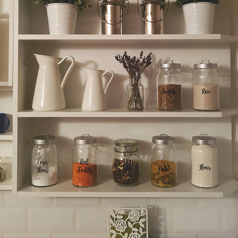 Pantry shelves with containers labelled with Nutmeg word stickers