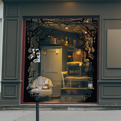 A shop window decorated for Halloween with spooky window stickers by Nutmeg Studio