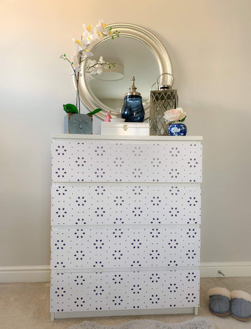 White flatpack chest of drawers revamped with Nutmeg furniture stickers in a navy blue flower pattern