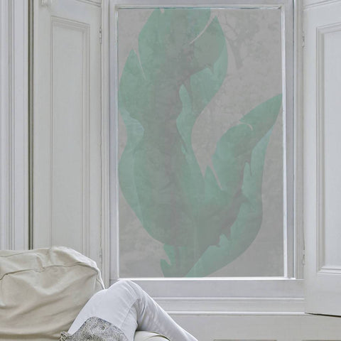 Large Tropical Leaves Window Film on a while-framed window