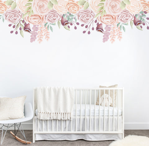 Floral wall mural on a white wall above a white cot