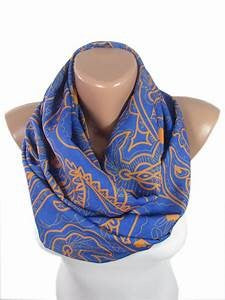 Blue scarf with orange accents.