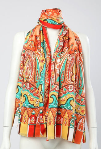 Orange scarve with green and blue accents.