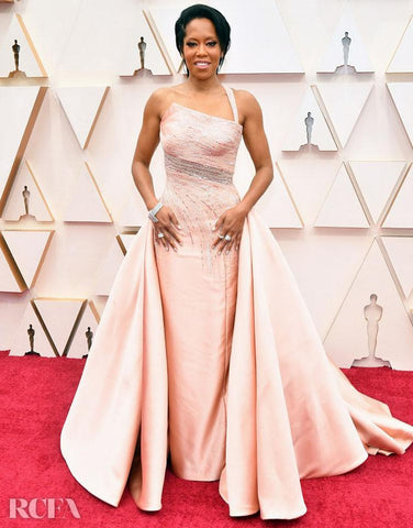 Regina King in a Versace sculpted gown in pale pink.