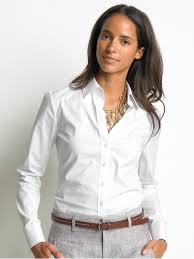 Woman wearing a white collared shirt