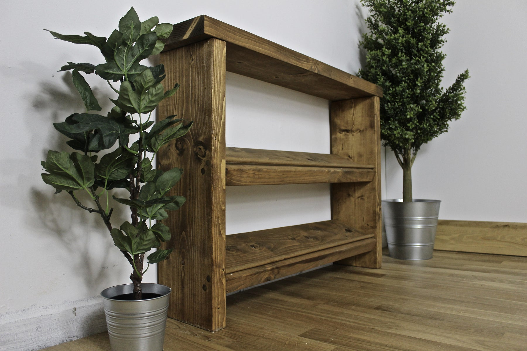 Rustic Redlynch Shoe Rack handcrafted by new forest rustic furniture and finished in a dark oak finish.