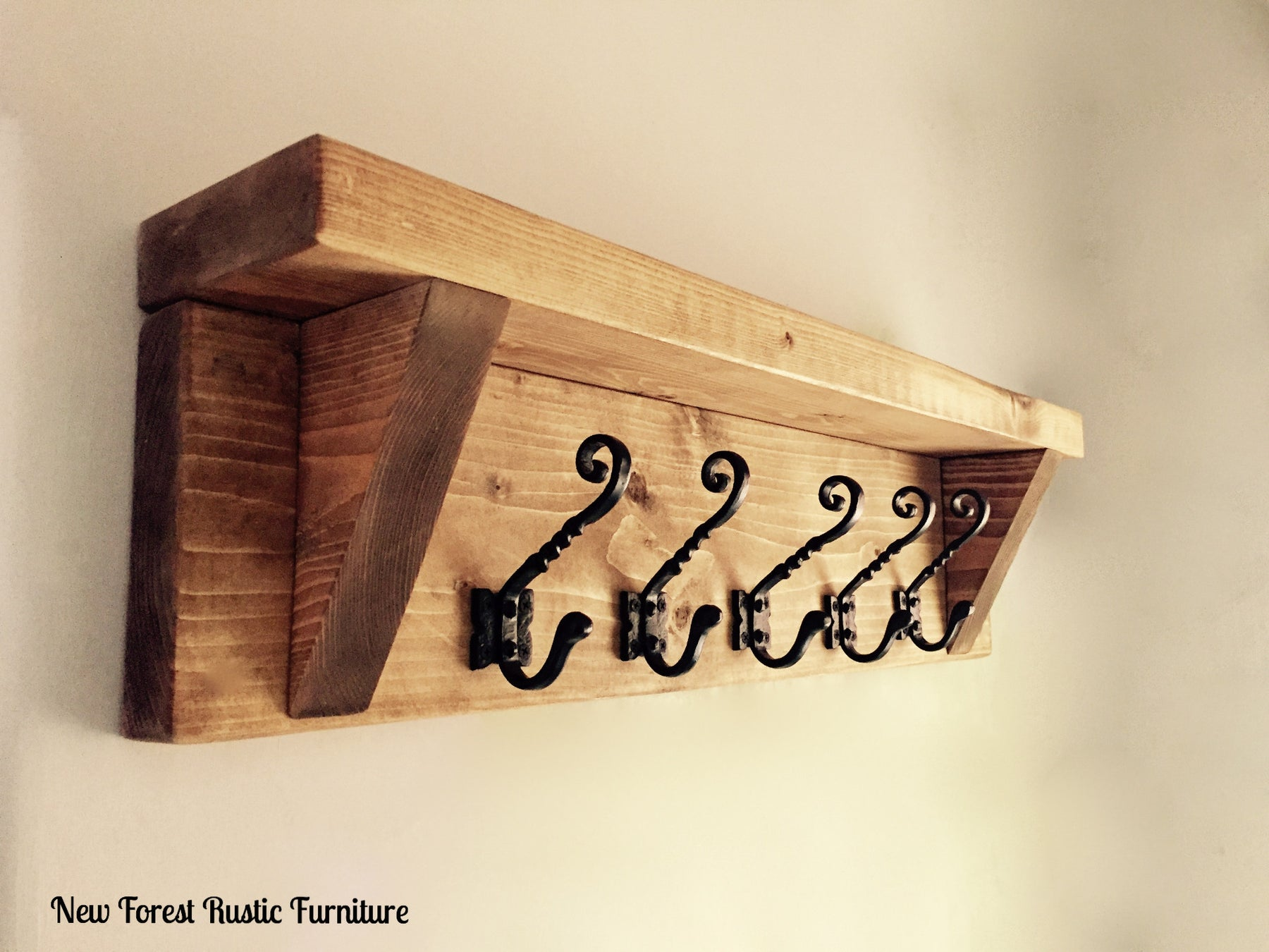 Chunky Rustic Wellow coat rack hook, complimented with black cast iron hooks, handcrafted by new forest rustic furniture. Finished in a Medium oak