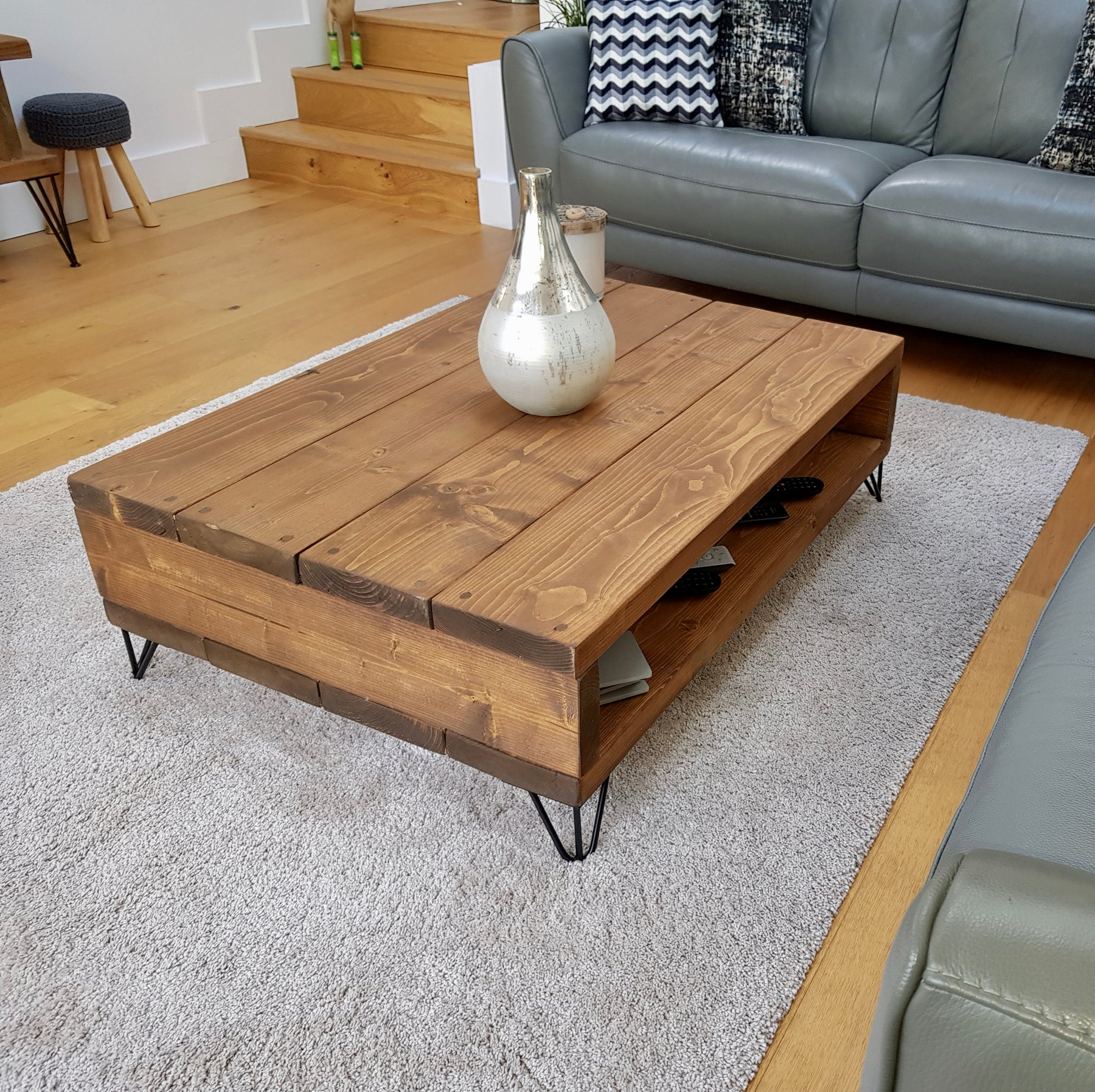 rustic frogham tv unit with industrial metal legs. Handcrafted by new forest rustic furniture finished in a dark oak