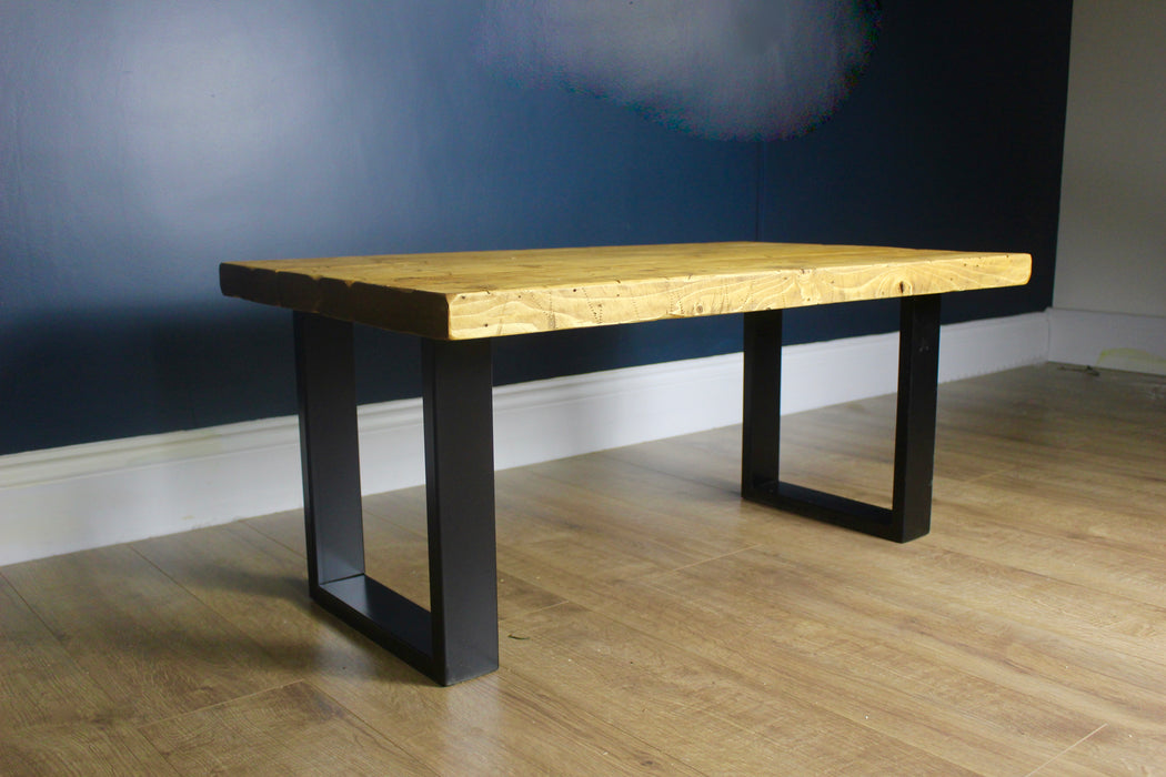 distressed industrial coffee table handmade by new forest rustic furniture finished in medium oak. including black metal industrial legs