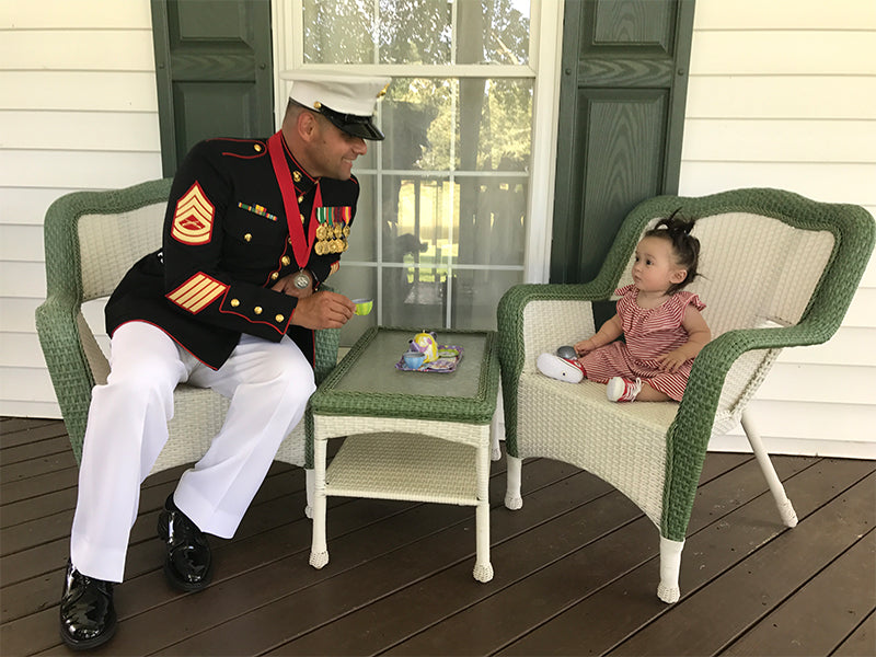 Gunnery Sergeant Mauricio Velasquez on Porch with Child