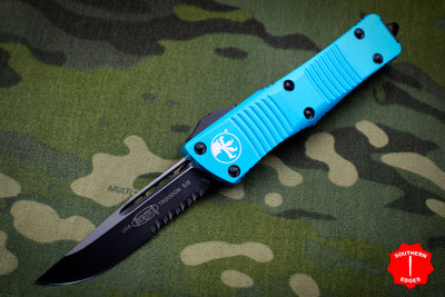 Microtech Troodon Turquoise Single Edge OTF Knife with Black Part Serrated Blade 139-2 TQ