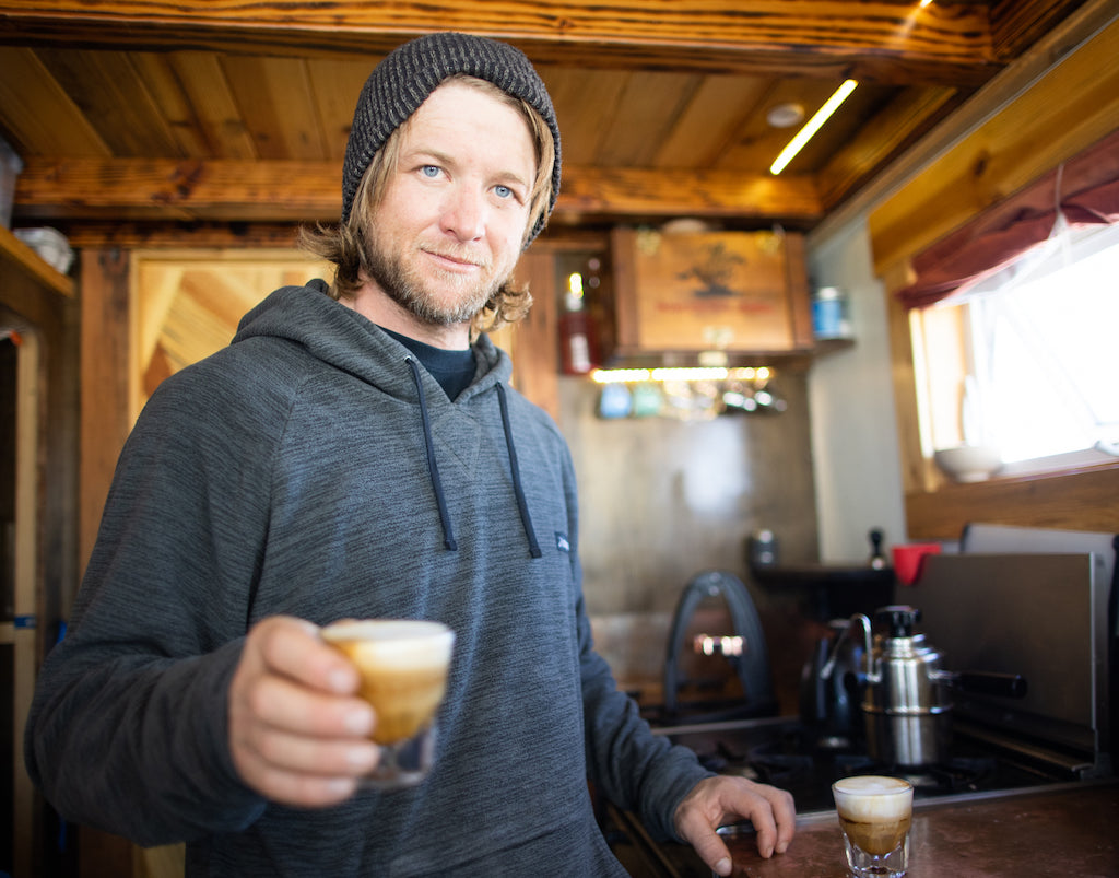 Eric Boomer with a coffee in his tiny home