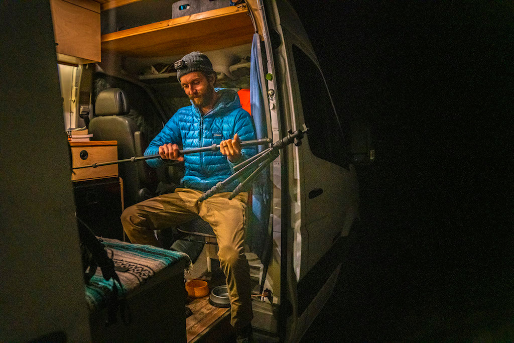 Man in camper Van prepping for taking photos outside