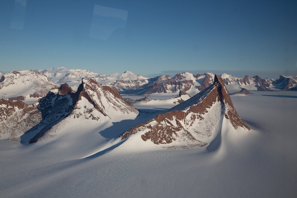 Snowy landscape of a mountain range in the artic