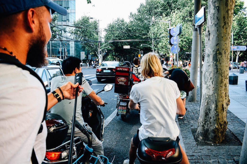 People on Scooters in busy traffic