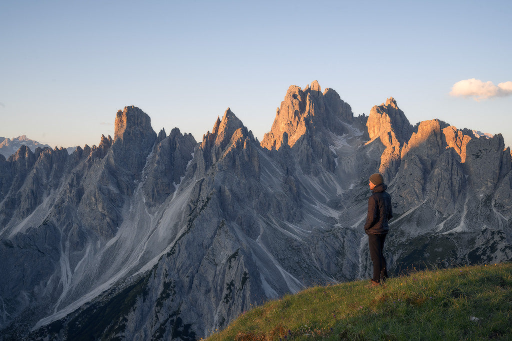 Man standing in front of mountains