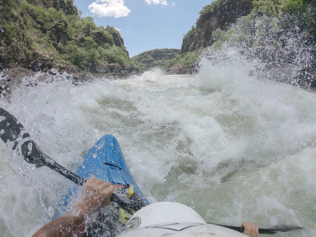 Blue kayak in a whitewater river