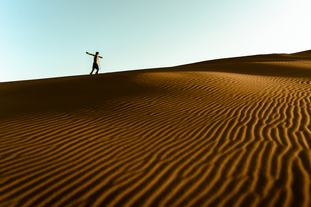 Photo of guy at sand dunes