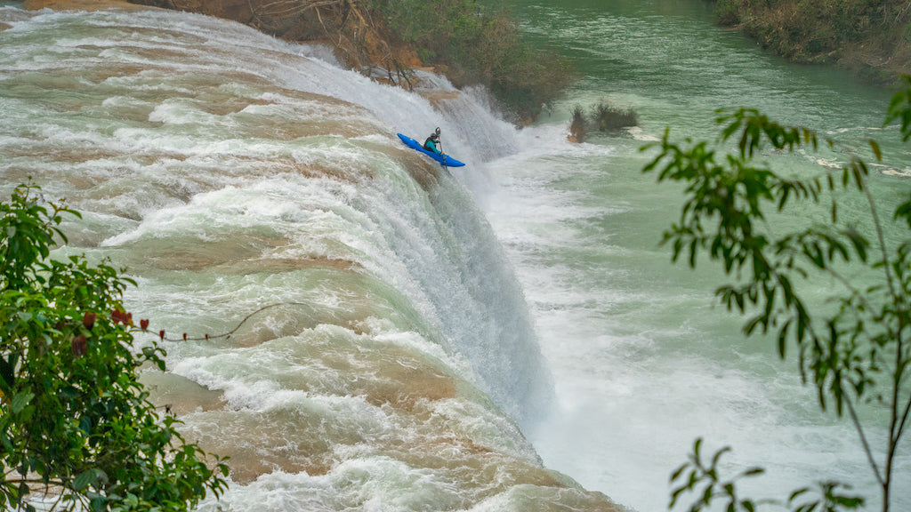 Kayaker going down the Asesca River