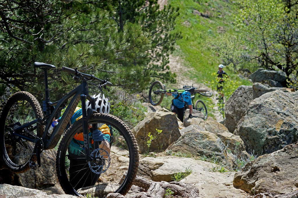 "Local mountain bikers hike-a-bike to the top of Lookout Mountain to complete the ""Trifecta,"" or to summit the three tallest peaks surrounding Spearfish, in only a day."