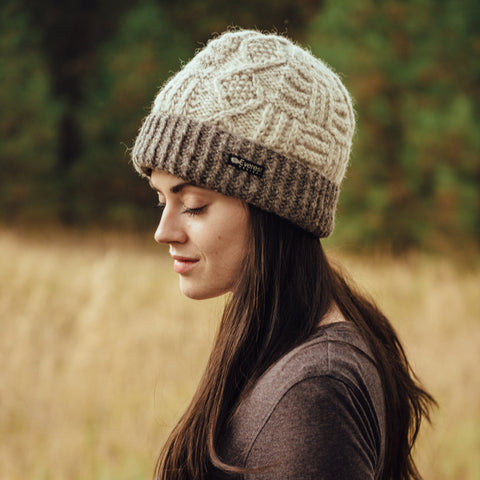Woman wearing a white Everest Designs Nepali wool Cable Cuff Beanie