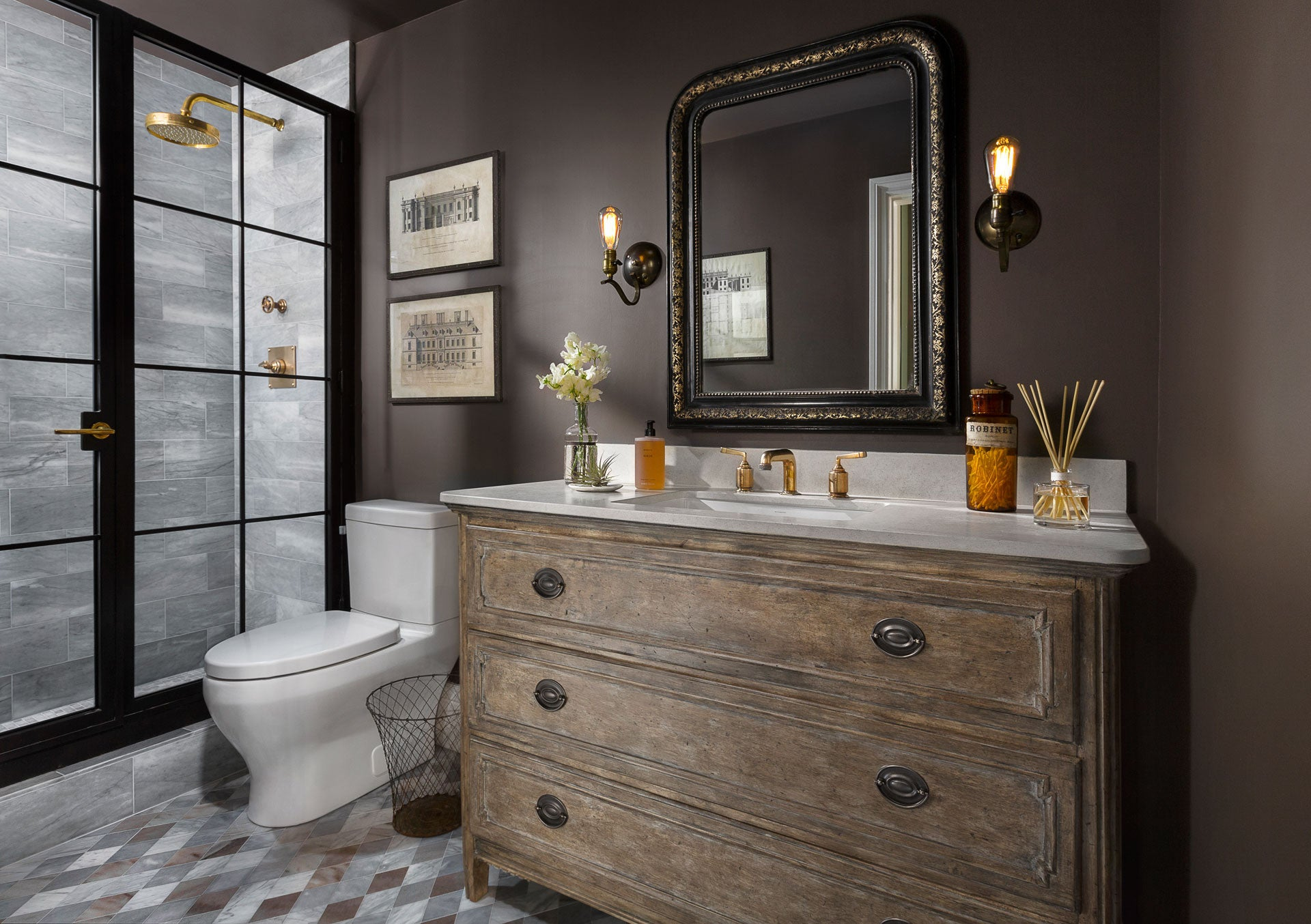 Beautiful bathroom design with rich deep brown walls. Design by Kymberley Fraser of A Beautiful Mess Home. #bathroom #brownwalls #farrowandballtannersbrown