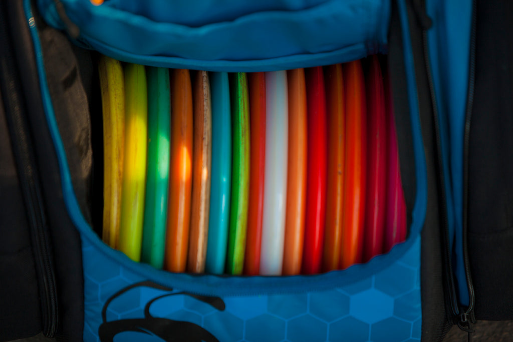 Colorful discs in a disc golf bag